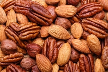 gluten intolerance symptoms can continue after a gluten free diet if the problem is not gluten. Image is of nuts