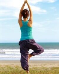 woman doing yoga becuase of mental effects of gluten free diet