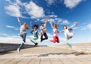 Teens jumping for joy