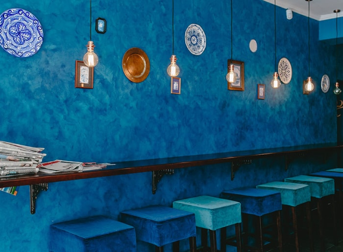 100 percent gluten free restaurant with blue walls and pendant lights