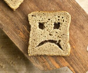 A sad face on a piece of toast becuase doctors don't understand celiac disease