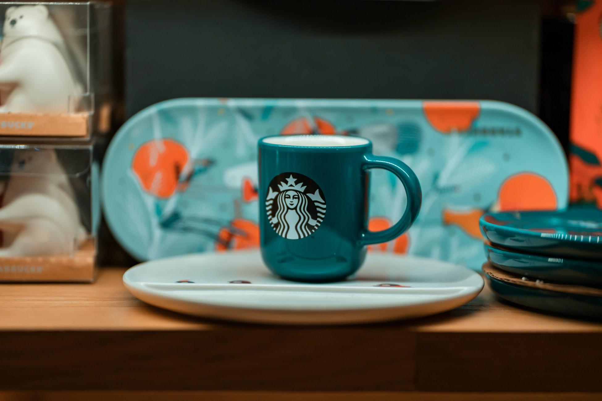 A Starbuck's mug containing an oat milk latte