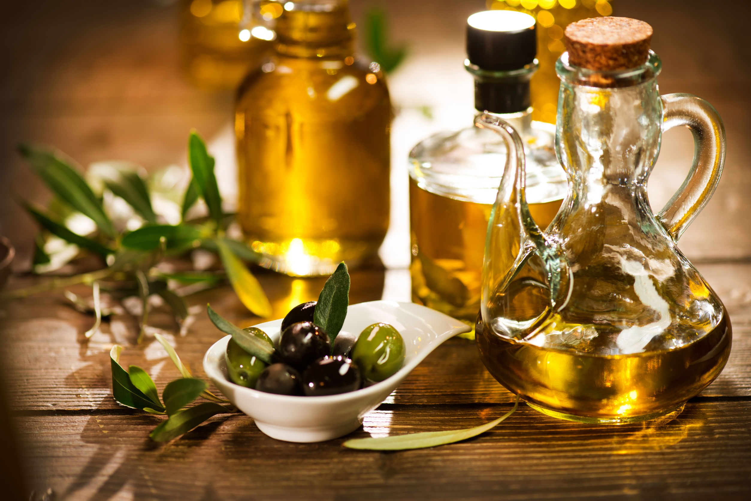 Mediterranean diet is good for the gut microbiome and celiac disease- image is of olive oil bottles