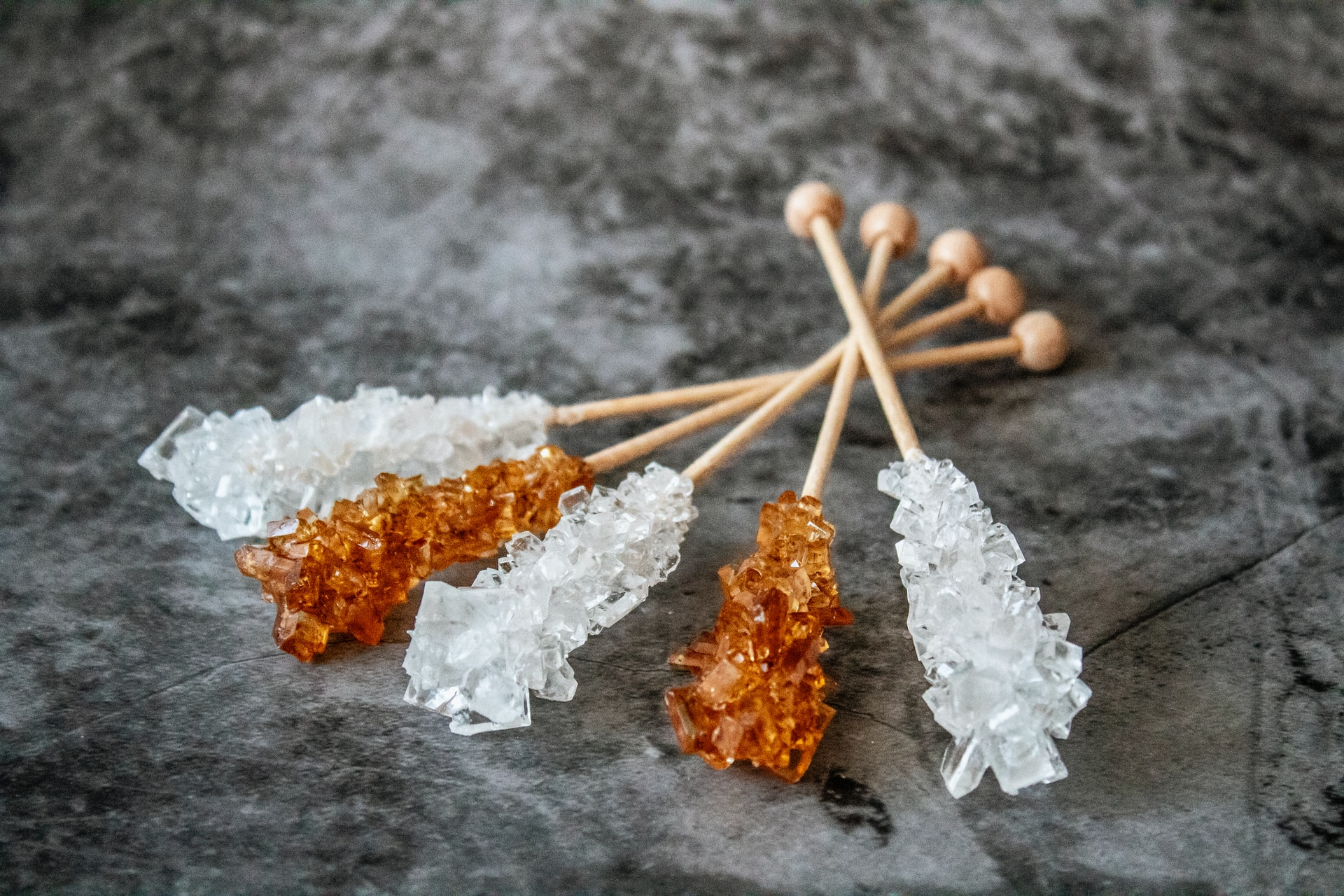 Sucrose intolerance is due to eating foods that contain sucrose like this rock candy-if you are low in the enzyme to digest sucrose-symptoms occur