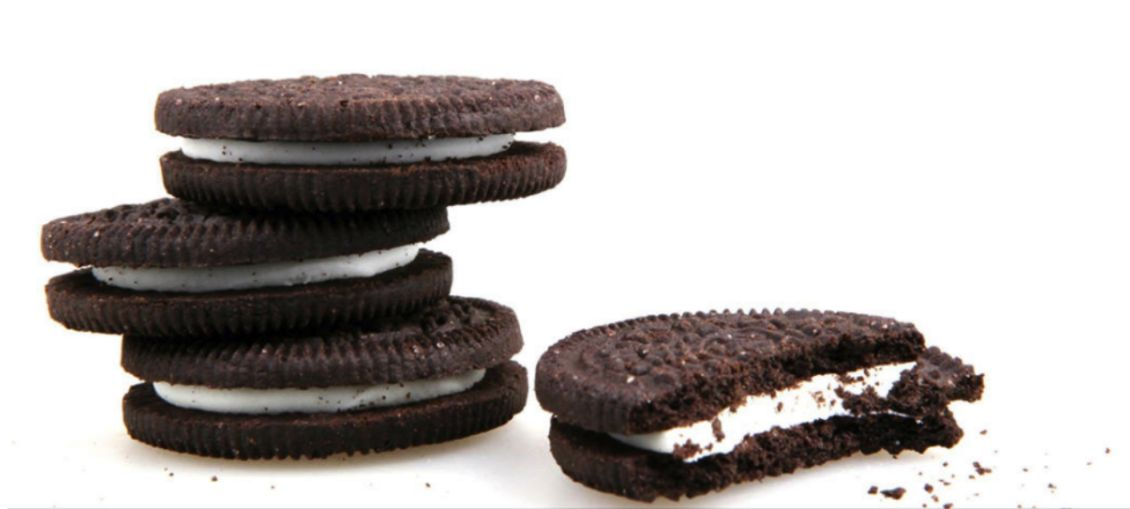 three oreos stacked and one oreo bitten in half
