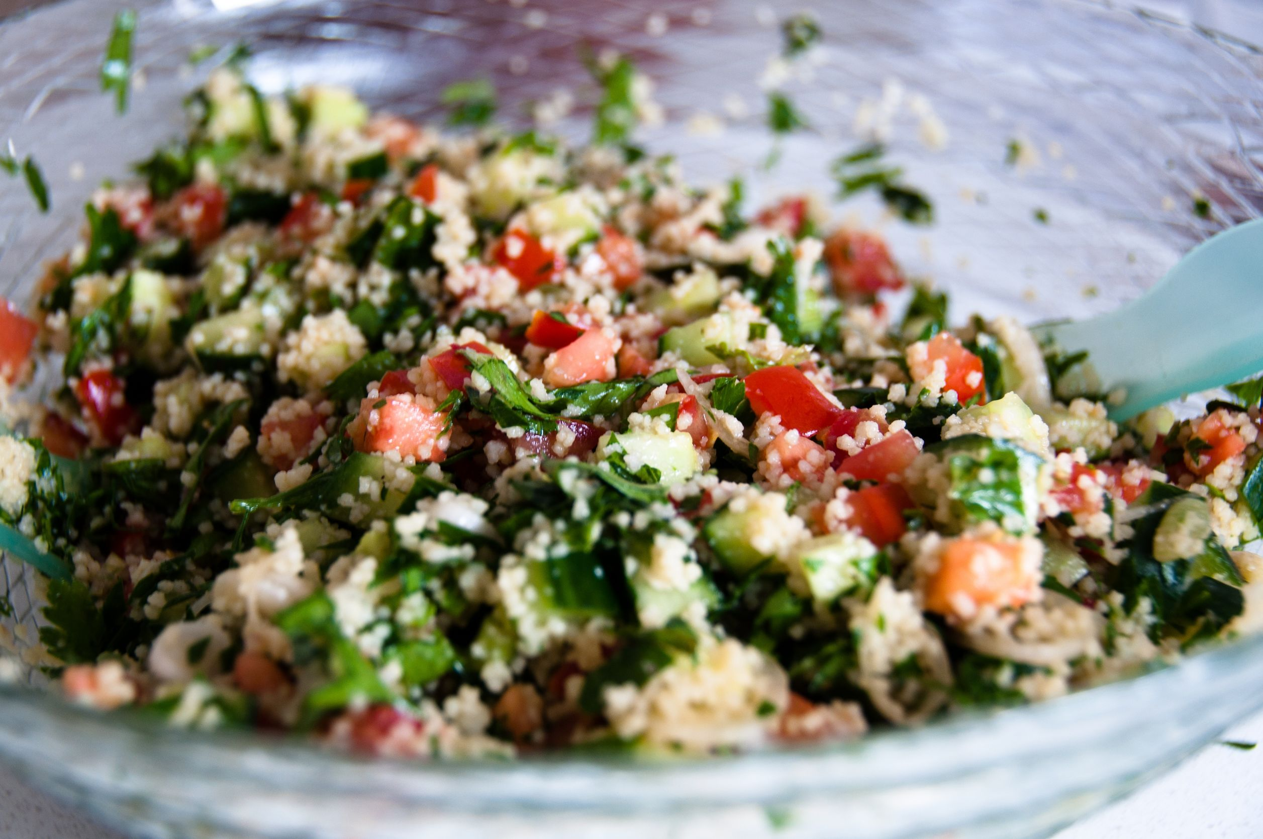 Fonio tabouleh on a plate. Fonio is a grain that has health benefits. Fonio recipes are in the article
